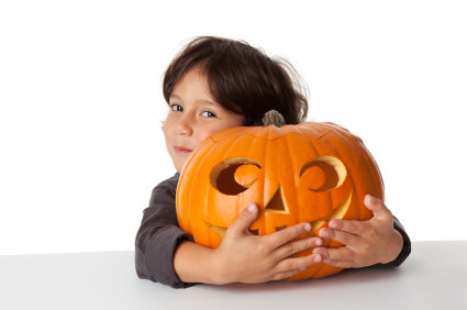Halloween pumpkin and child