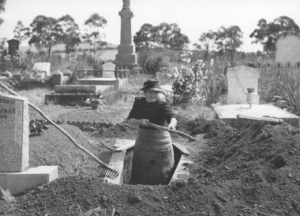 woman digging up grave in 1944