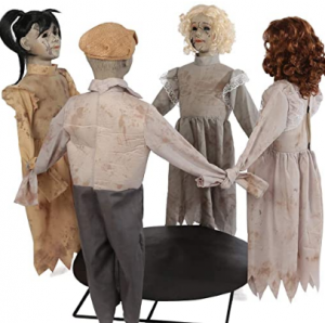 doll children dressed as ghosts